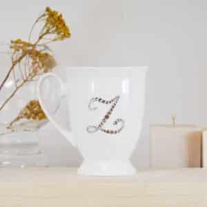 """Porcelianinis puodelis su """"Z"""" raide"""
